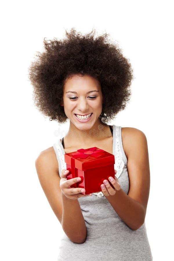 Het houden van een gift stock afbeelding