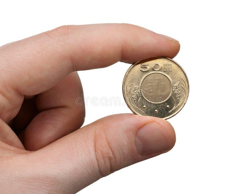 Het houden van een Muntstuk van Dollar 50 NT stock foto