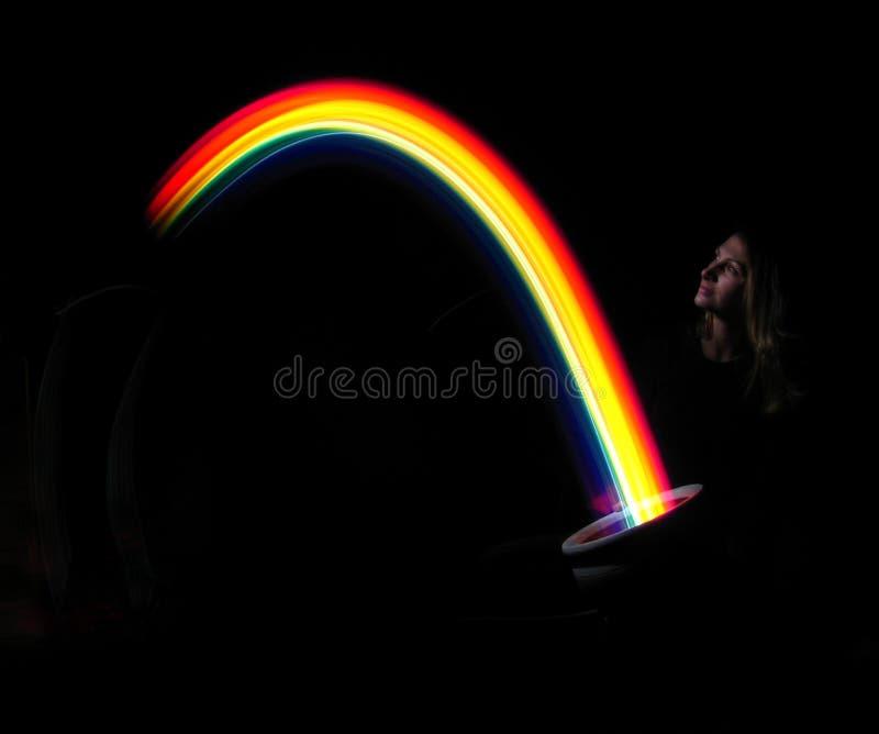 Het houden van een regenboog stock illustratie