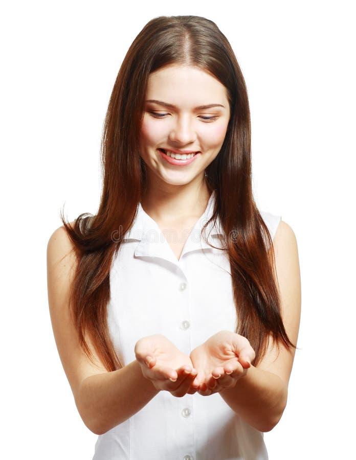 Het houden van haar hand die iets tonen stock foto