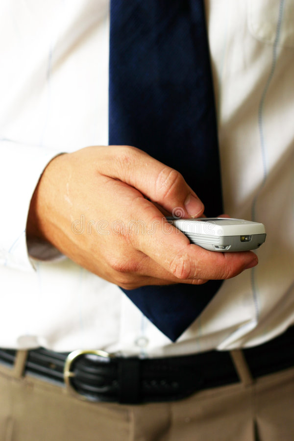 Het Houden Van Mobiele Telefoon Stock Foto