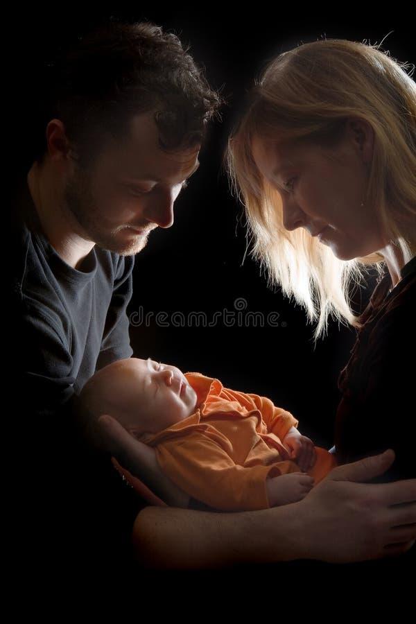Het houden van van hun baby stock afbeeldingen