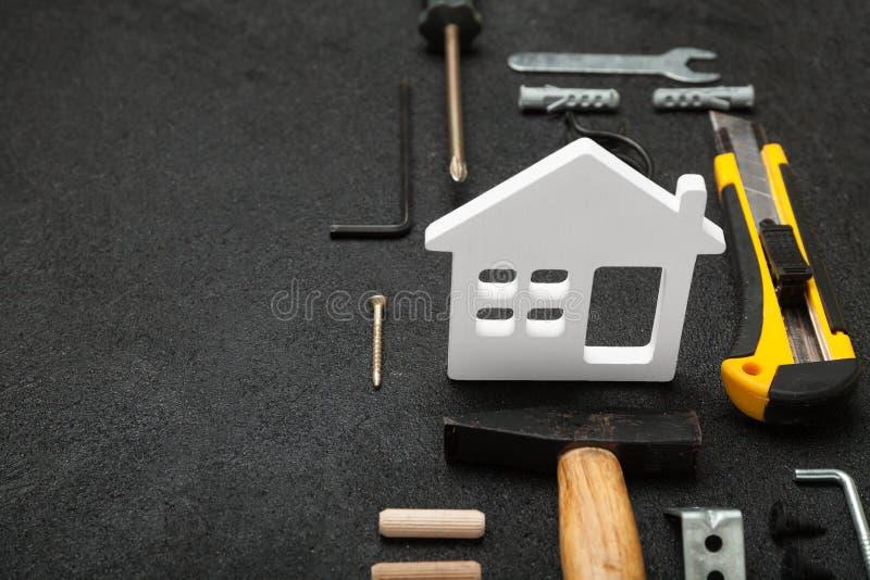 Het houten concept van de huisbouw, diy woningbouw stock afbeelding