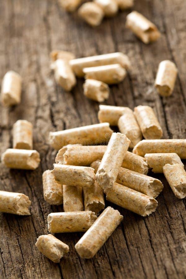 Het houten korrel .ecological verwarmen stock fotografie