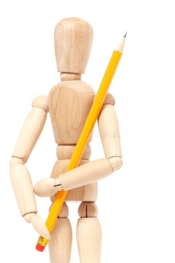 Het houten potlood van de marionettenholding stock fotografie