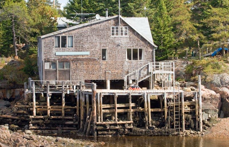 Het huis en het dok van de visser stock foto's