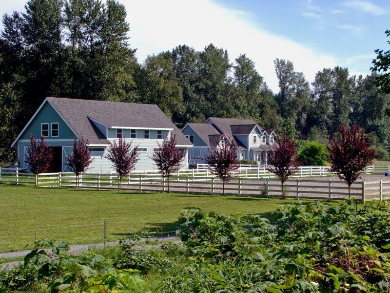 Het huis en het modelleren van het land stock afbeelding