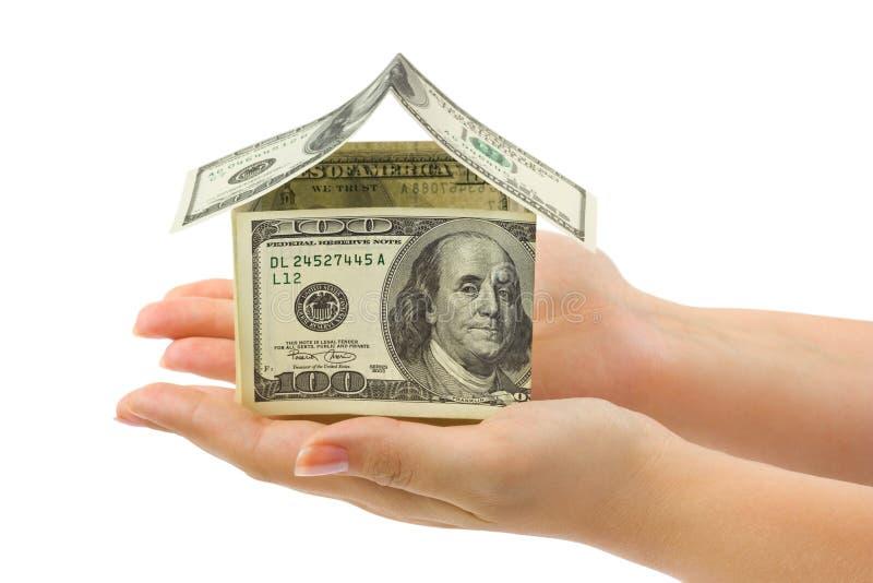 Het huis van het geld in handen stock foto