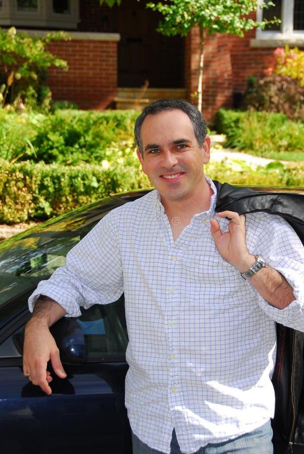 Het huisauto van de mens stock foto