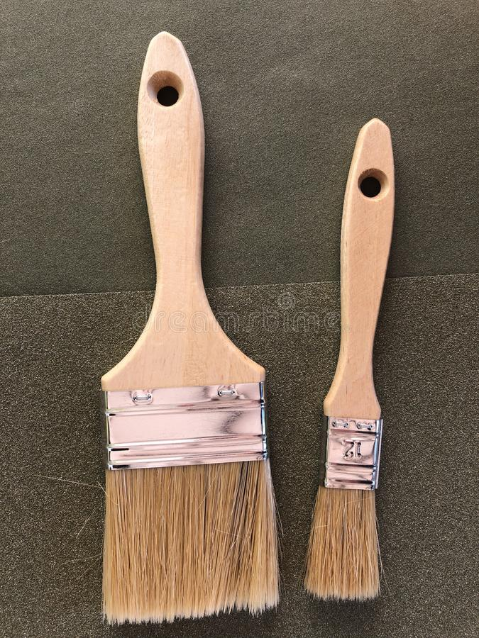 Het huisverbeteringen en DIY, twee verfborstels royalty-vrije stock foto