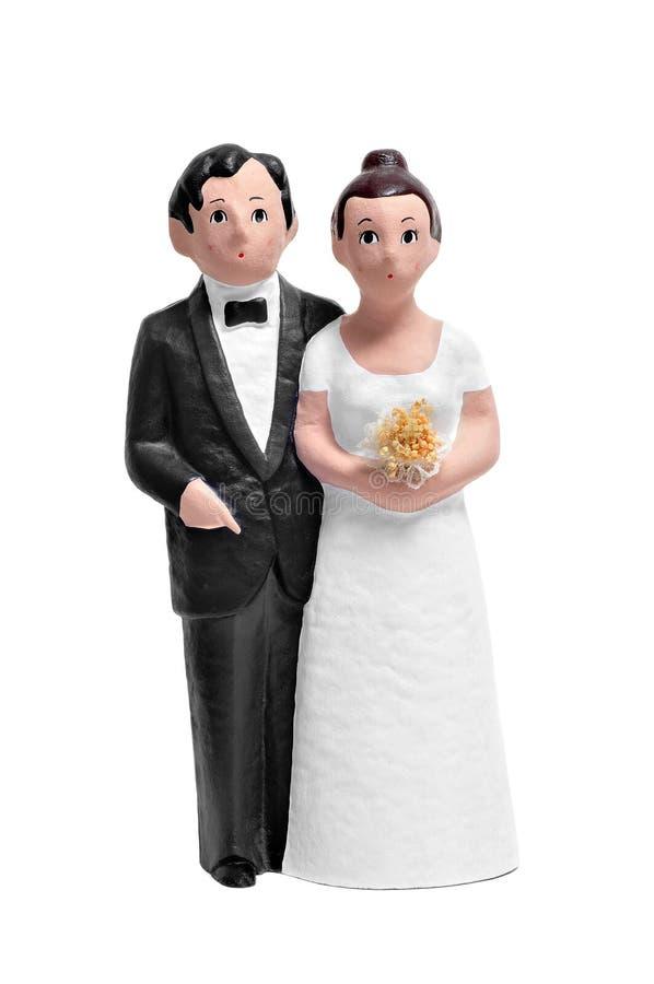Het huwelijkscake van het paar topper stock afbeeldingen