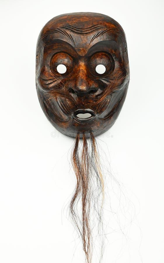 Het Japanse houten masker van het theater menselijke die gezicht op wit wordt geïsoleerd royalty-vrije stock foto