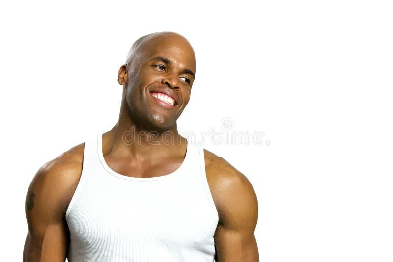 Het jonge Aantrekkelijke Glimlachen van de Mens Geïsoleerde op Wit stock afbeelding