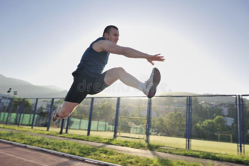Het jonge atleet lopen royalty-vrije stock afbeeldingen