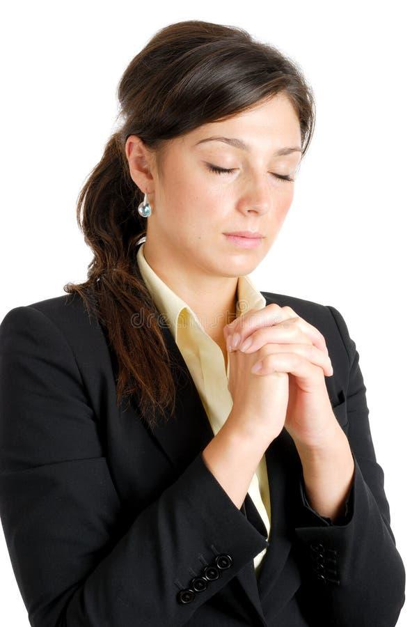 Het jonge bedrijfsvrouw bidden royalty-vrije stock fotografie