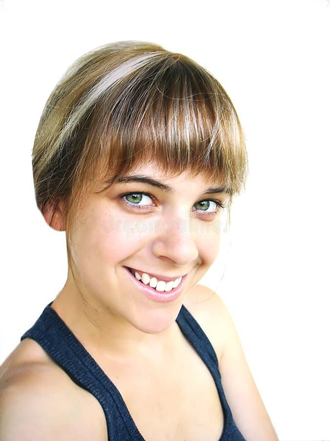 Het jonge blonde vrouw glimlachen royalty-vrije stock foto
