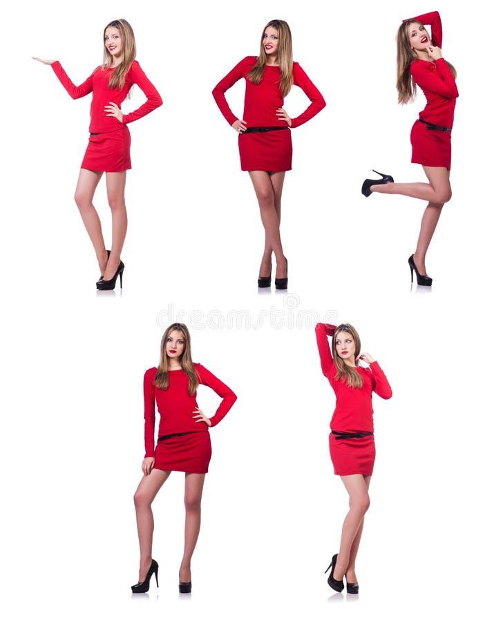 Het jonge blondemeisje in rode korte die kledingsholding op wit wordt geïsoleerd royalty-vrije stock afbeeldingen