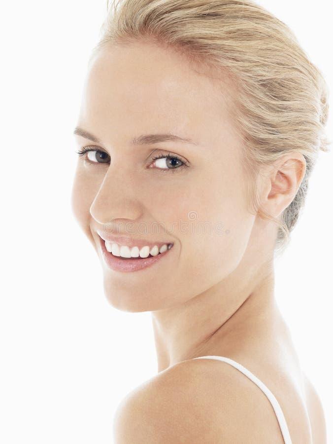 Het jonge Blondevrouw Glimlachen royalty-vrije stock afbeelding