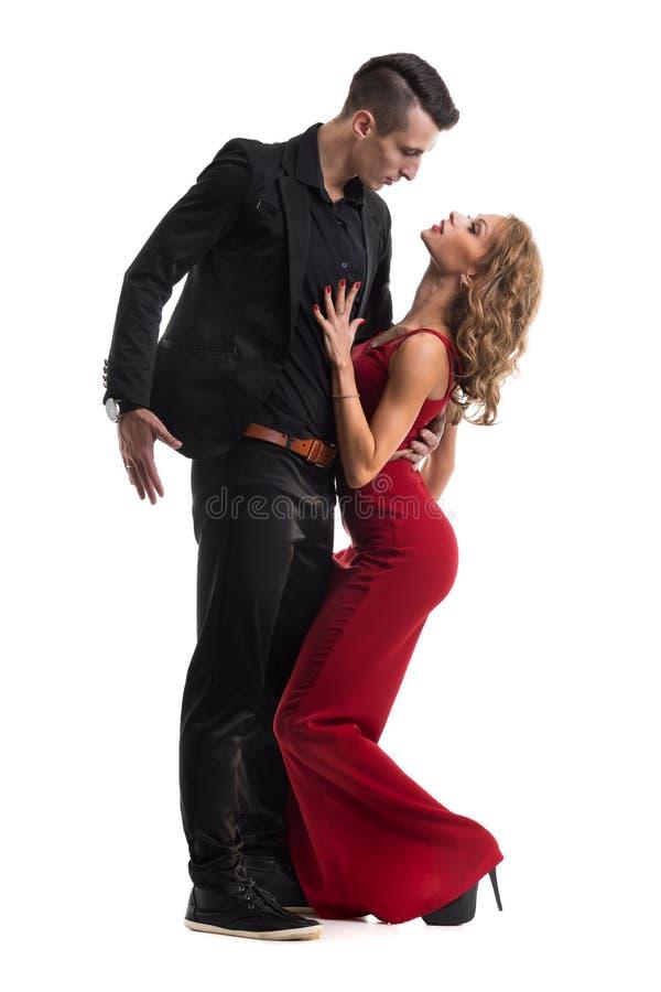 Het jonge elegante paar dansen, geïsoleerd op wit royalty-vrije stock foto