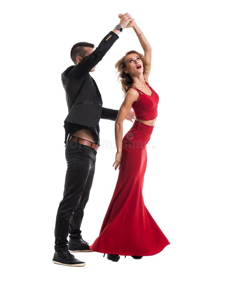 Het jonge elegante paar dansen, geïsoleerd op wit royalty-vrije stock afbeeldingen