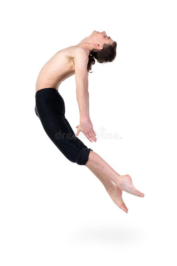 Het jonge en modieuze moderne balletdanser springen stock afbeelding