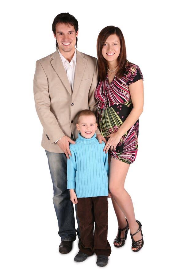 Het jonge familie stellen, zwangere moeder stock afbeeldingen
