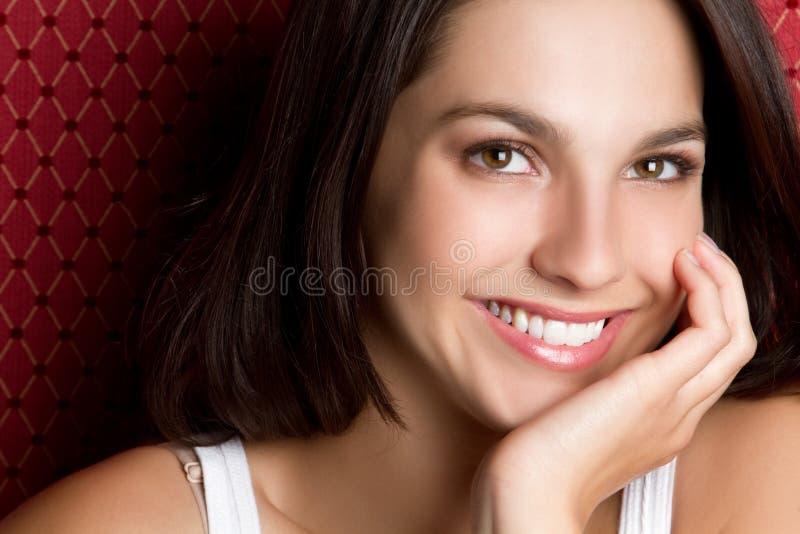 Het jonge Glimlachen van de Vrouw royalty-vrije stock afbeelding