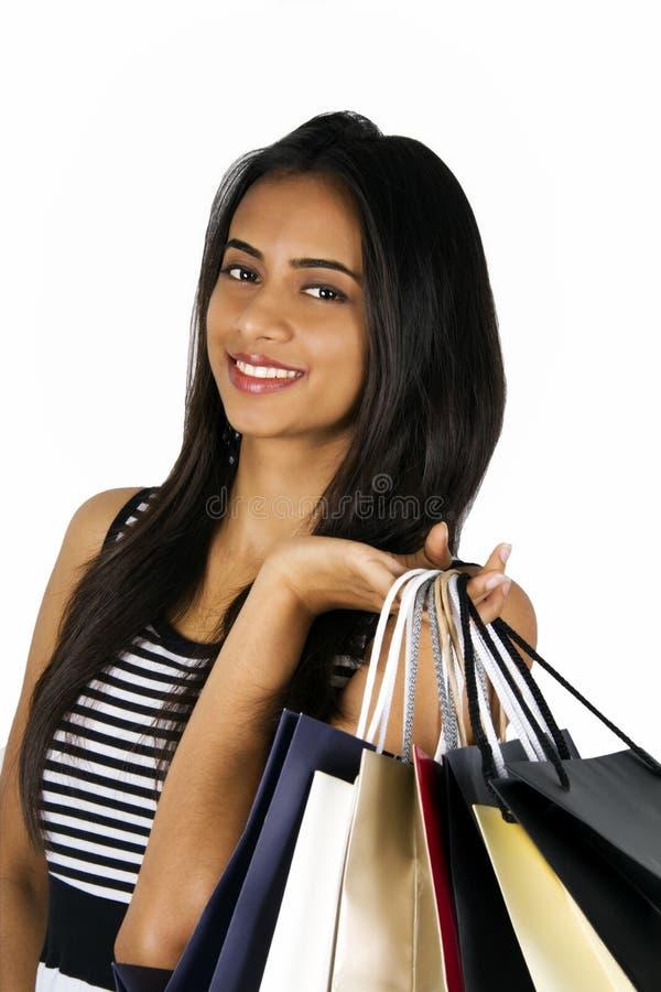 Het jonge Indische meisje winkelen. stock afbeeldingen