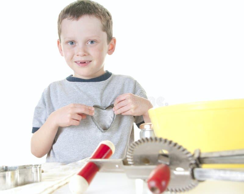 Het jonge jongen koken royalty-vrije stock foto's