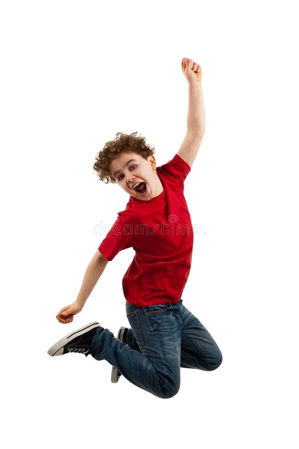 Het jonge jongen springen stock fotografie