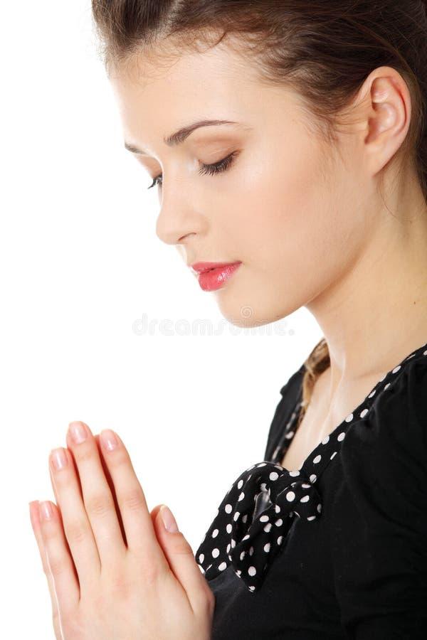Het jonge Kaukasische vrouw bidden stock foto's