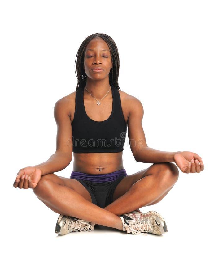 Het jonge Mediteren van de Vrouw royalty-vrije stock afbeelding