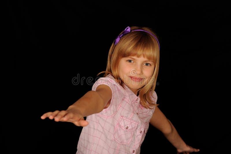 Het jonge meisje in evenwicht brengen royalty-vrije stock foto