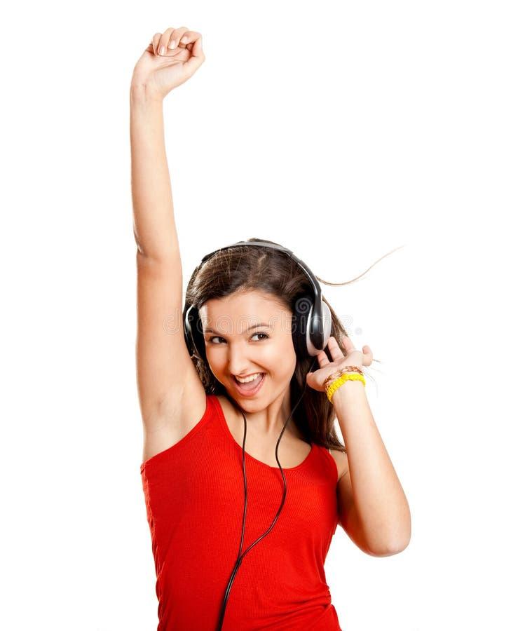Het jonge meisje luistert muziek stock afbeeldingen