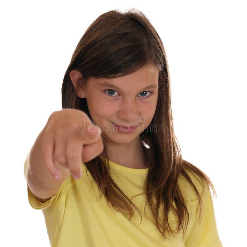 Het jonge meisje richten met haar vinger wil ik u stock afbeelding