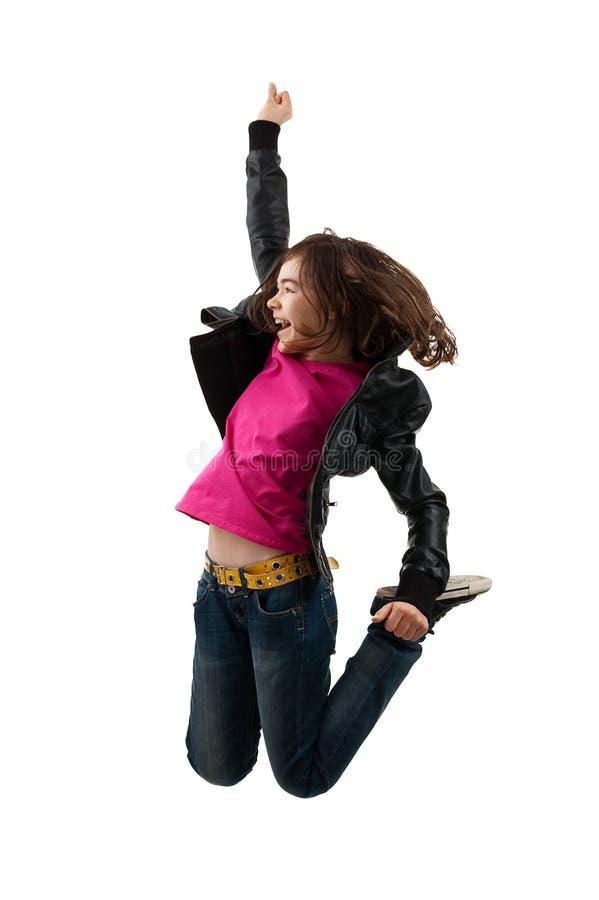 Het jonge meisje springen stock foto