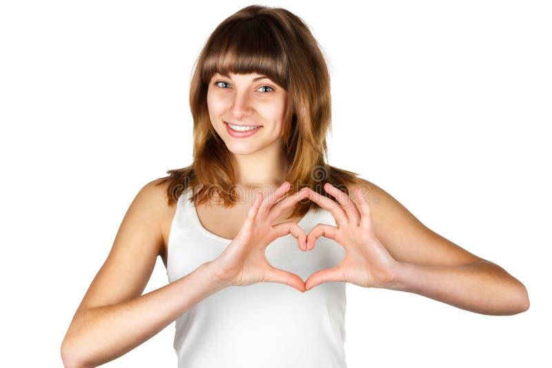 Het jonge meisje toont hart royalty-vrije stock afbeelding