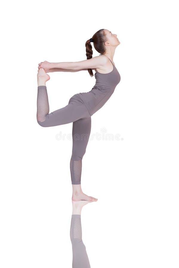 Het jonge meisje voert verschillend uit stelt van yoga, flexibel mooi model op een witte achtergrond meditatie en asanas royalty-vrije stock foto's