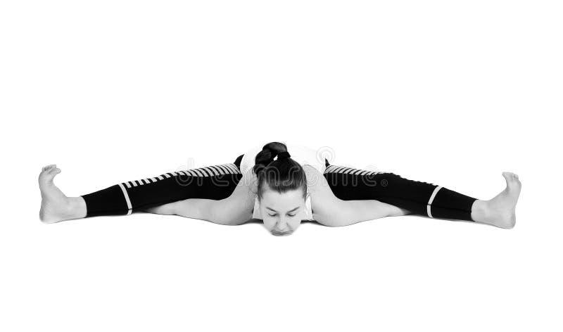Het jonge meisje voert verschillend uit stelt van yoga, flexibel mooi model op een witte achtergrond meditatie en asanas royalty-vrije stock fotografie