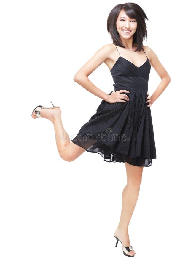 Het jonge, Mooie Chinese meisje opgewekt springen stock foto's