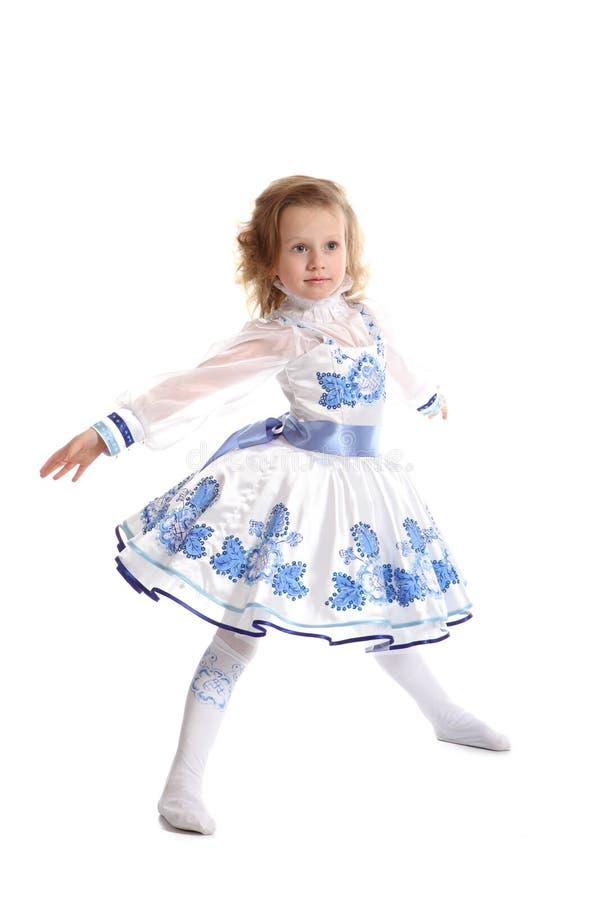 Het jonge mooie meisje in een blauwe kleding royalty-vrije stock afbeeldingen