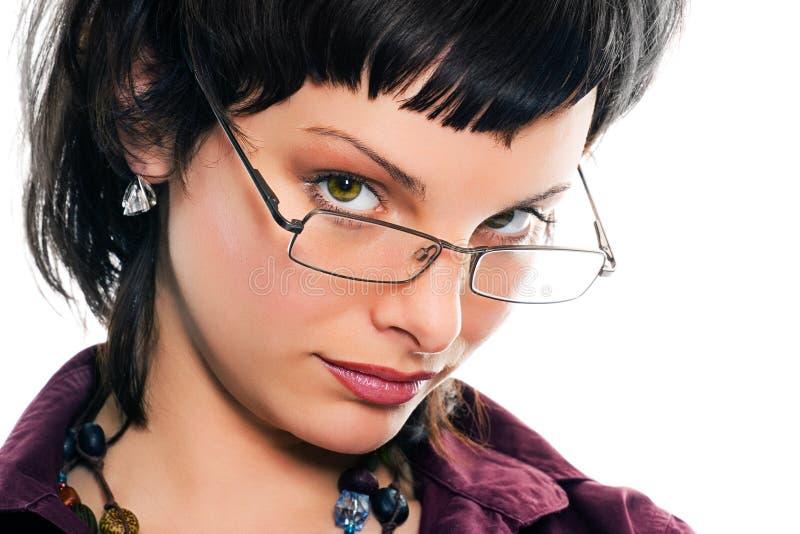 Het jonge mooie meisje van het portret in glazen royalty-vrije stock foto's