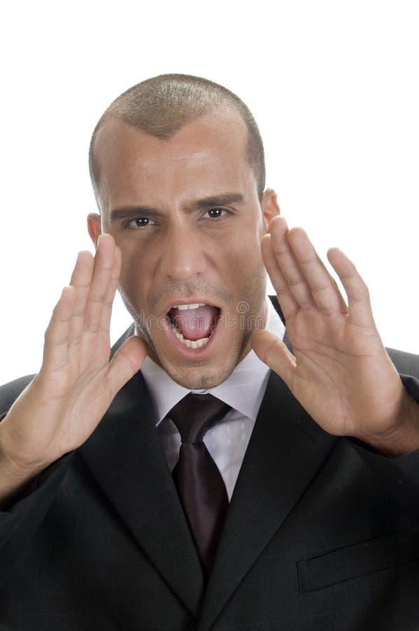 Het jonge professionele mens schreeuwen stock foto