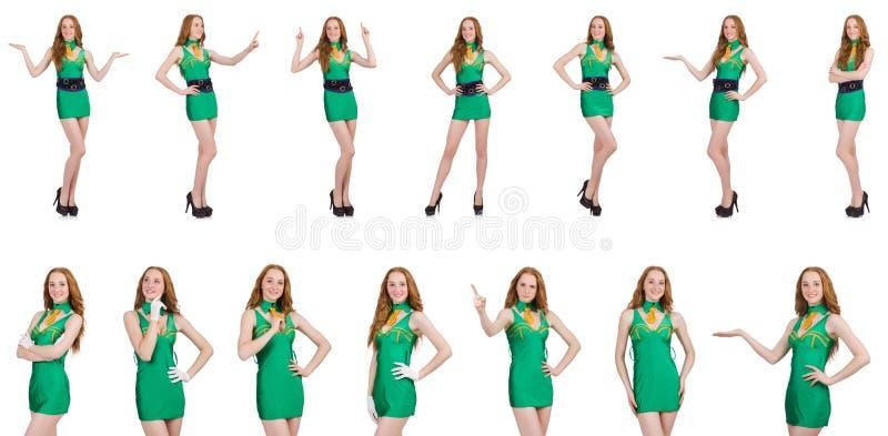 Het jonge sexy meisje in groene die kleding op wit wordt geïsoleerd royalty-vrije stock afbeeldingen
