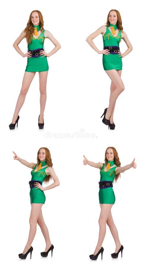 Het jonge sexy meisje in groene die kleding op wit wordt geïsoleerd stock afbeelding