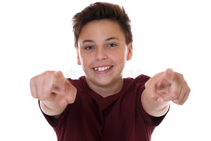 Het jonge tienerjongen tonen met zijn vinger wil ik u royalty-vrije stock fotografie