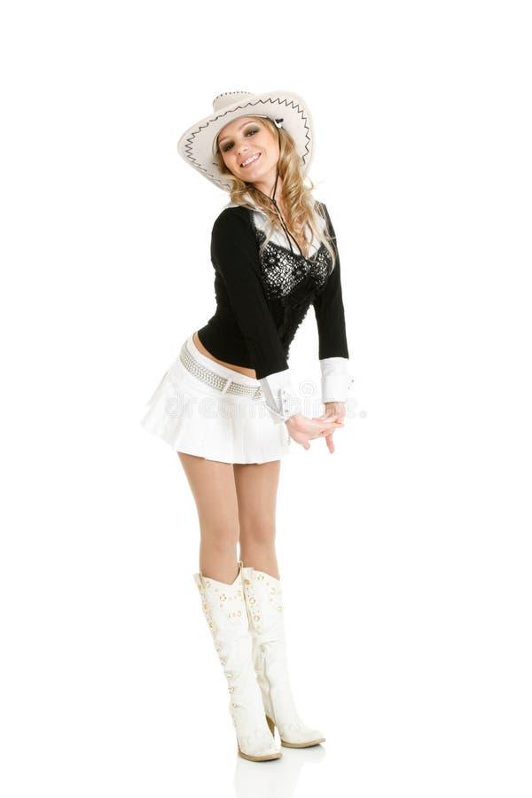 Het jonge veedrijfstervrouw dansen stock afbeeldingen