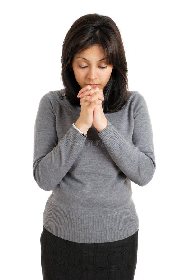 Het jonge vrouw bidden royalty-vrije stock afbeeldingen