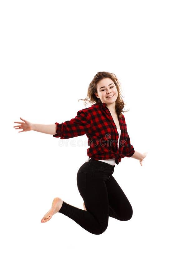 Het jonge vrouw springen stock foto's