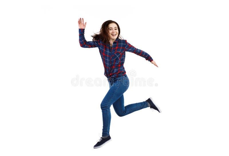 Het jonge vrouw springen stock fotografie